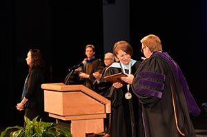 Carolyn B. Stone accepts here award from President Delaney