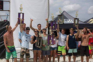 UNF's surf team holds up its trophies