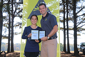 UNF cross country runner Eden Meyer poses to show off her ASUN Championship medalist honor