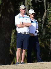 UNF golfer Philip Knowles stands with Coach Scott Schroeder who served as his caddie for the event