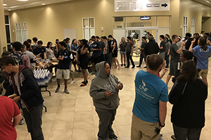 UNF students evacuated to the Fountains for safety during hurricane gather to pick up food and water