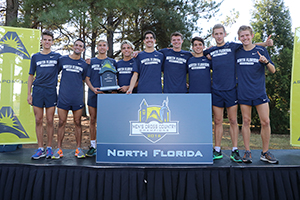 UNF Men's Cross Country team pose after winning first-ever conference title