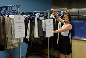 Student worker shows off clothing now available at Ozzie's Closet