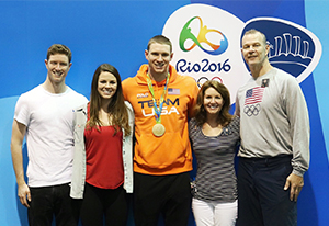 Swimmer Ryan Murphy stands with mother Katy and family at Olympics; photo by Cat Galletti