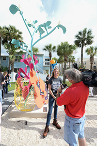 Student filmed as she stands by her sculpture on display at seaside park