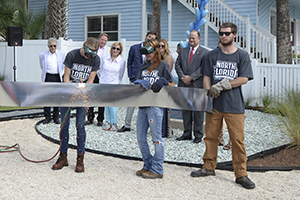 Student cuts metal ribbon at seaside park opening