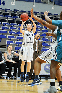 UNF women's basketball player Claire loannidis goes up for shot