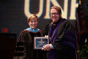 Professor Caroline Guardino poses with President John Delaney for Outstanding Graduate Teaching Award