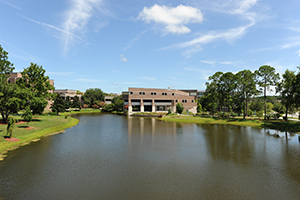 UNF campus photo overlooking the water and building
