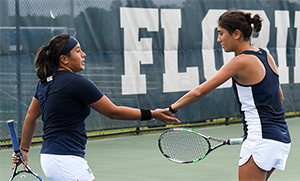 UNF women's tennis players on the court