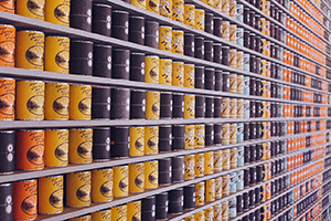 Canned food stacked on a market shelf