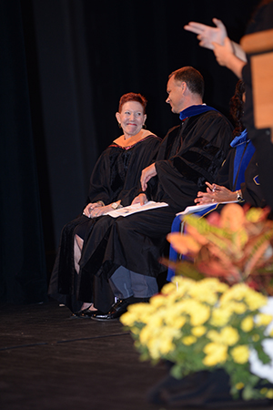 Distinguished professor Dr. Catherine Christie on stage for award presentation