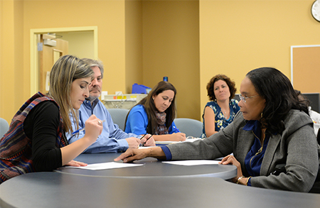 UNF student Marianthi Angjellari (left) talks with Dr. Otilia Salmon (far right)