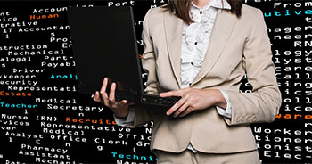 Woman holding laptop in front of job titles