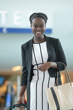 UNF student Mansenie Joseph at the airport
