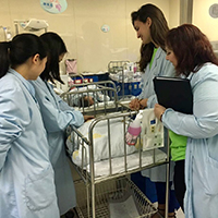 Theresa Pola and Johanna Vogt with nurses at hospital in Shanghai.
