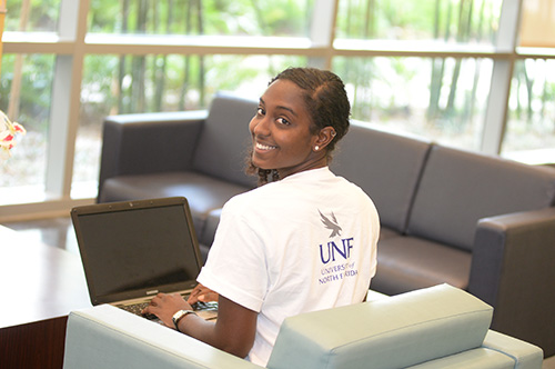 UNF student working on a laptop