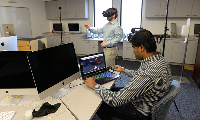 Dr. Sandeep Reddivari (right) and Jason Smith demonstrate virtual reality tool
