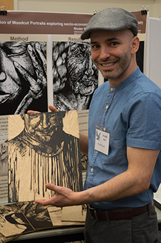 UNF student Ricder Ricardo poses with art