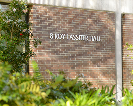 New sign on Building 8 shows Roy Lassiter Hall