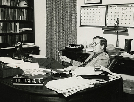 Roy Lassiter at desk in the 1970s