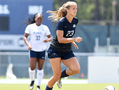 UNF women's soccer player Krista Colubiale on field