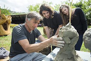 professor sculpting with students