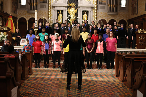 Dr. Cara Tasher directs chorus at the Cathedral Basilica of St. Augustine, photo credit Arvie Witherspoon