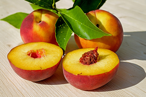Peaches, with one cut open