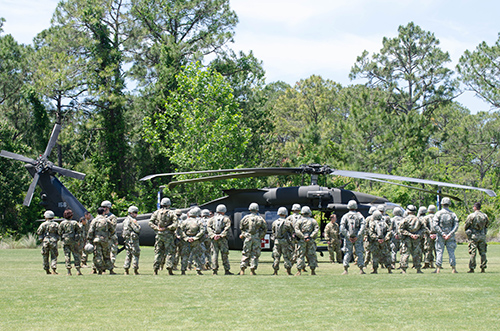 Army ROTC students gather around helicopter