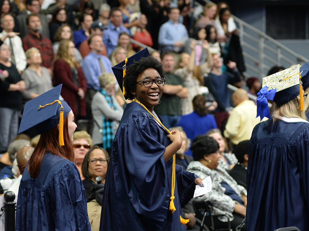 Happy UNF graduate at Commencement
