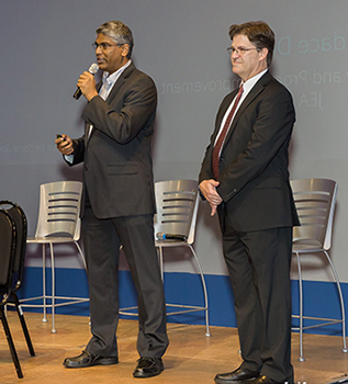 Dr. Karthikeyan Umapathy (left) and Dr. Dan Richard present before audience
