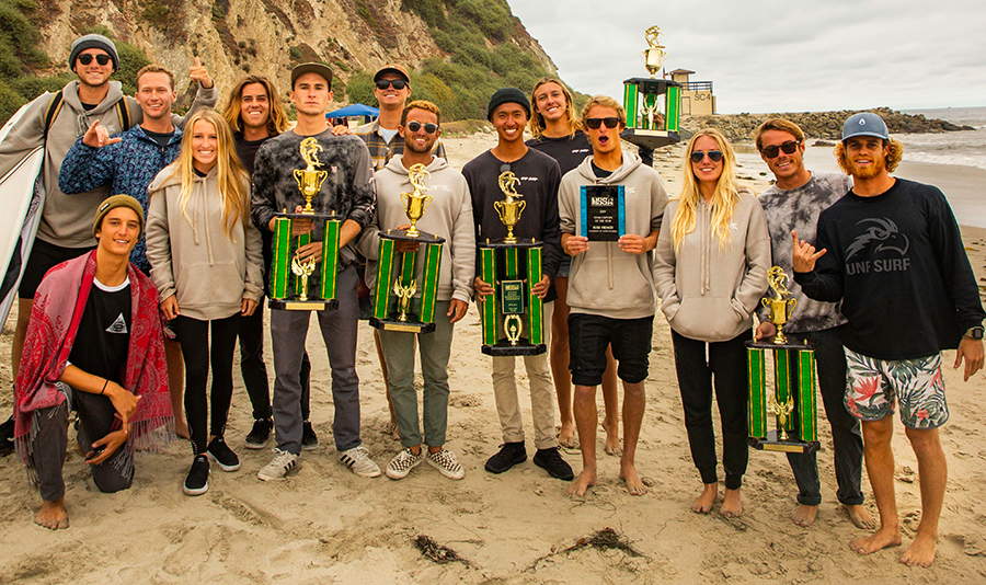 UNFs surf team holding trophies