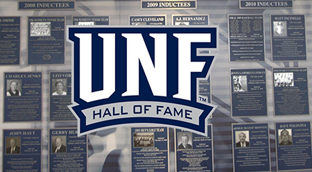 UNF Hall of Fame logo over inductees wall