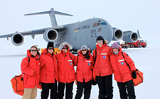 Group, including UNF biology professor Julie Richmond, in front of plane in Antarctica