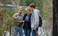 Justin Lemmons and students in the Sawmill Slough Preserve