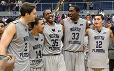 Basketball teammates celebrate after a win
