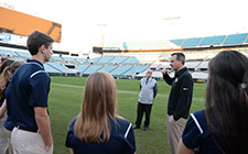 Jags Head Athletic Trainer Scott Trulock talks to UNF scholarship recipients