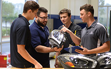Students and alum working on Mercedes-Benz headlights