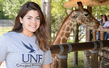 UNF student at the zoo hear giraffes