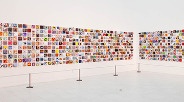 2011 Imagination Squared installation featuring five-by-five inch canvases hung on a white wall