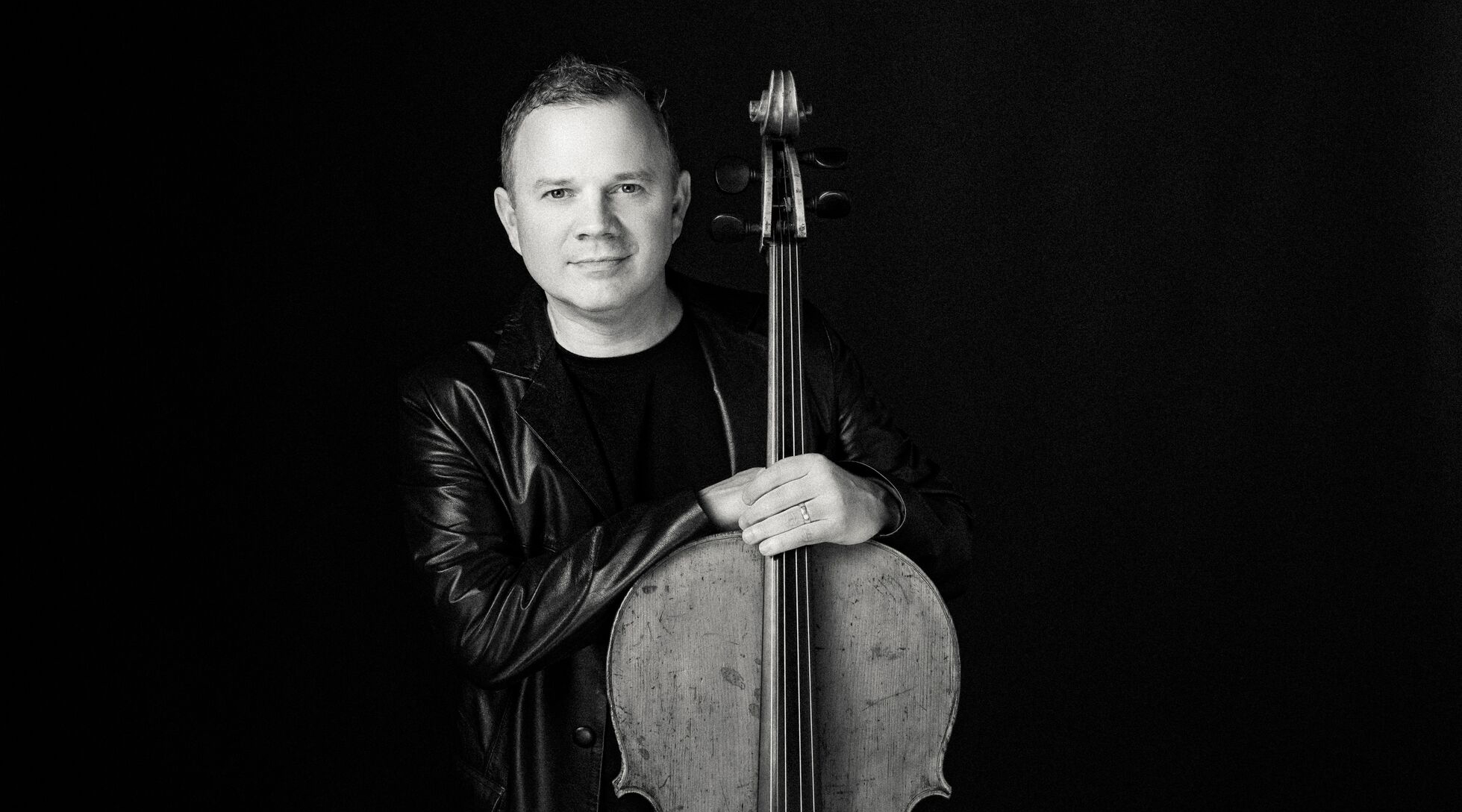 Professor Nick Curry holding his cello
