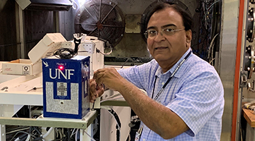 Dr. Patel working on a NASA high altitude balloon project in a lab setting