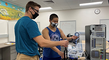 Two students working in engineering lab on Osprey CREW project