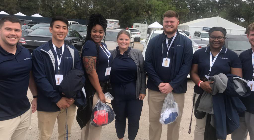 Sport Management Program students working at The Players Championship standing in group