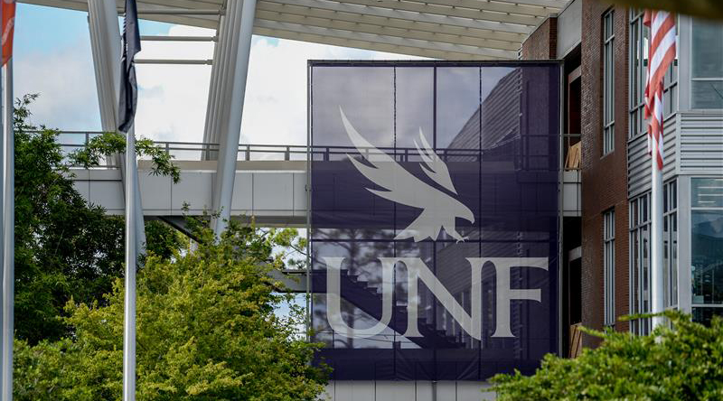 Large blue UNF banner hanging in the student union plaza