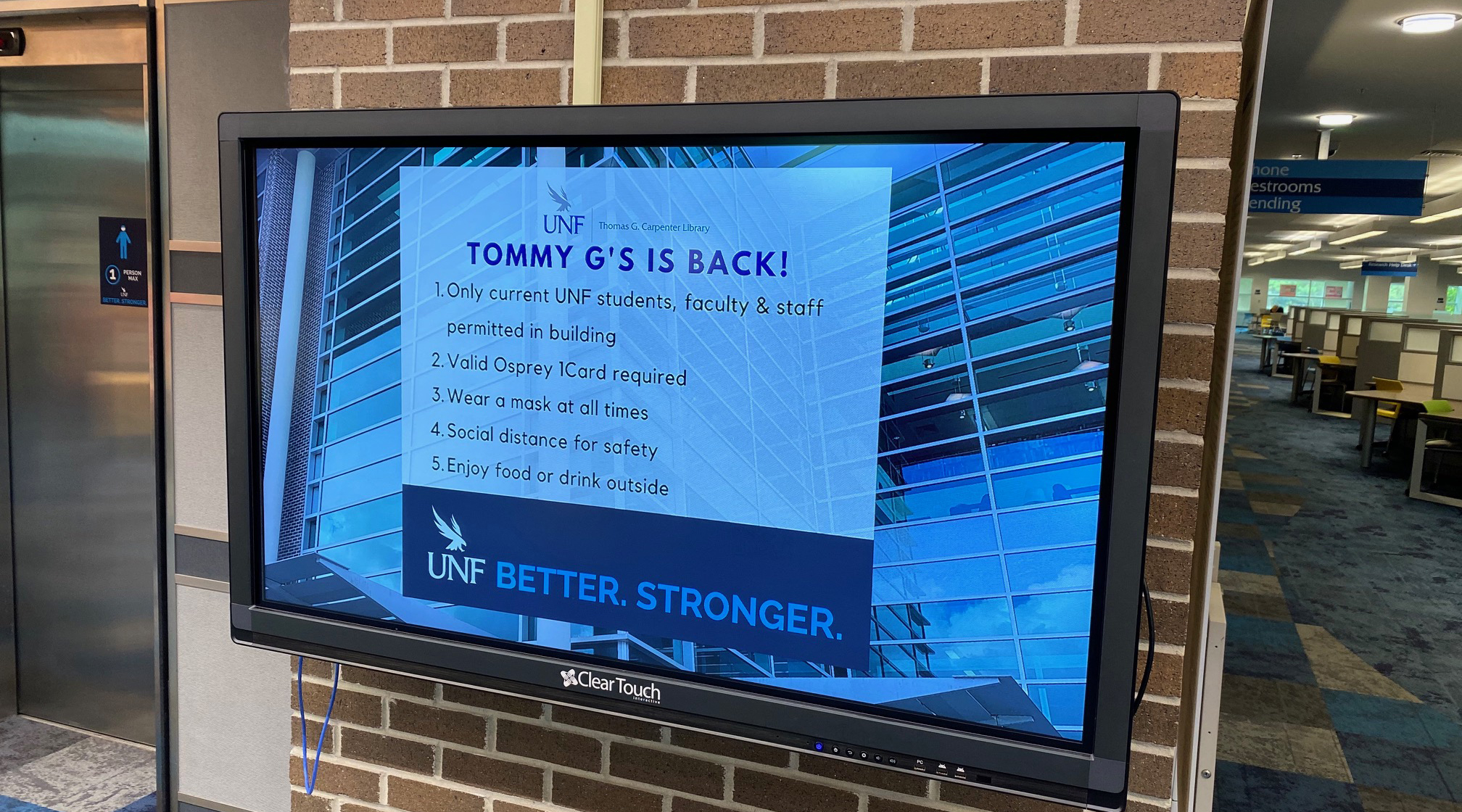 "TV screen in the library that reads ""Tommy G's is Back!"""