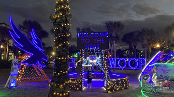 "UNF's display at Deck the Chairs featuring a large Osprey and the word ""swoop"" lit up in Christmas lights"