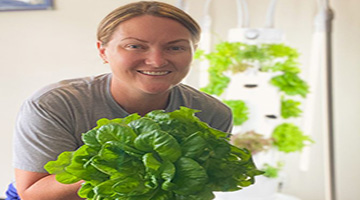 UNF Wellness Dietitians Kelly Schooley holding leafy greens