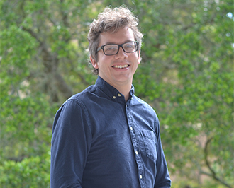 Matt in glasses and a blue button-up shirt